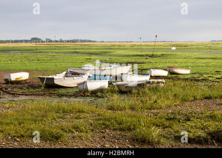 Image of numerous boats stranded in mud at low tide at Nore Rithe Emsworth Hampshire Uk - Stock Photo