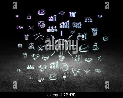 Business concept: Light Bulb in grunge dark room - Stock Photo