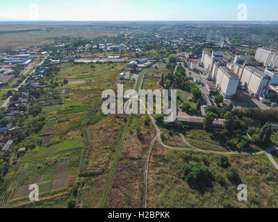 Top view of the small village. Aerophotographing above the village. - Stock Photo