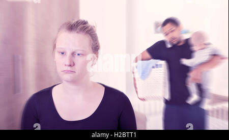 Young new mother suffering from postpartum depression - Stock Photo