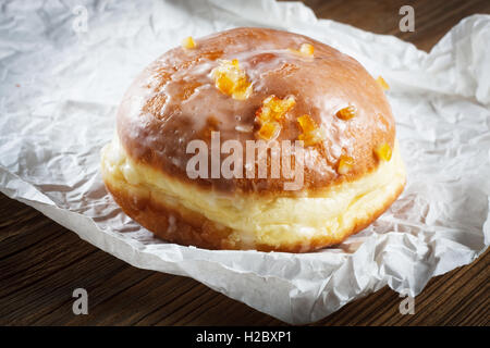 Doughnut filled with rose marmalade - Stock Photo