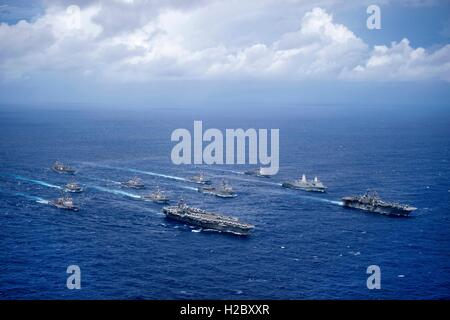 US Navy ships steam in formation during Valiant Shield exercises September 23, 2016 in the Philippine Sea. - Stock Photo