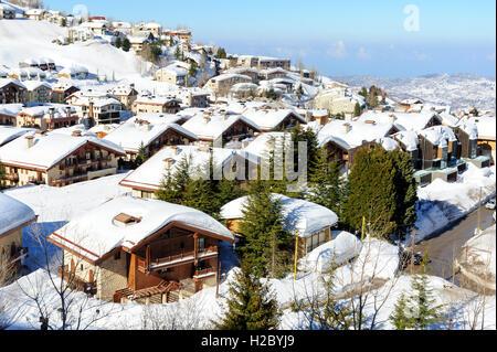 Mzaar Kfardebian ski resort in Lebanon during winter, covered with snow. It is also called Faraya. - Stock Photo