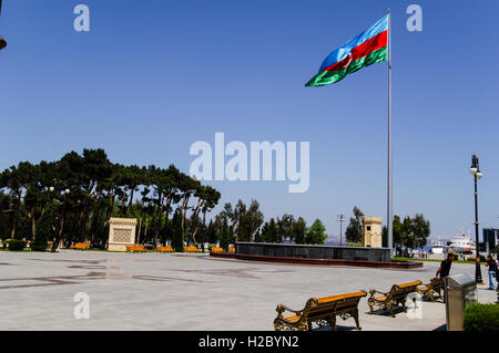 Azerbaijan, Baku. National Flag Square is a large city square by Neftchiler Avenue in Bayil, Baku. The flag flies - Stock Photo