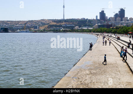 Azerbaijan, Baku. Baku Boulevard is a promenade that runs parallel to Baku's seafront. Baku TV Tower in the background, - Stock Photo