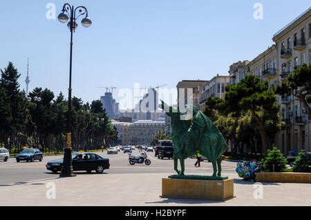Azerbaijan, Baku. A statue in front of the Azerbaijan State Carpet Museum. Flame Towers, a residential complex under - Stock Photo