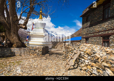Tibetan prayer stupa or prayers place of the faithful Buddhists in center Mountains Village. Blue Sky Background. - Stock Photo