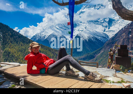Beautiful Woman Traveler Backpacker Take Rest Mountain Terrace Village.Young Girl Posing Smiling Camera.North Snow - Stock Photo
