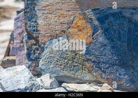 Closeup Photo Autentic Draw Stone Buddist Symbols and Mantras. Horizontal. Nepal Travel Trakking - Stock Photo