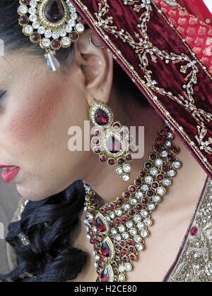 Asian wedding hands and jewelery, henna and gold - Stock Photo