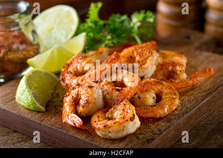 Delicious sauteed shrimp with cajun seasoning and lime on a maple plank. - Stock Photo