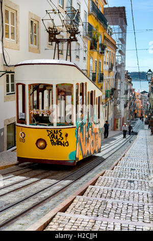 Lisbon, Portugal, 2016 05 06 - yellow tram - elevador da Bica standing on top of the rails - Stock Photo