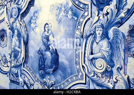Portugal: Historic blue and white tiles with Mother Mary holding infant Jesus - Stock Photo