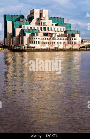 The SIS  MI6 MI5 building, reflection in river Thames London - Stock Photo