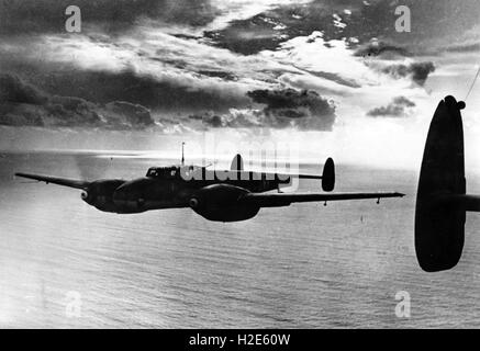 The Nazi propaganda image depicts an aircraft, type Messerschmitt Bf 110 of the German Wehrmacht at a recon flight - Stock Photo