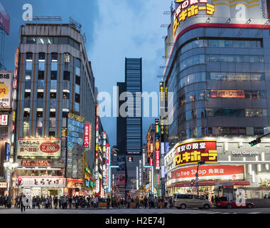 Kabukicho, crossing at nightfall, Shinjuku, Tokyo, Japan - Stock Photo
