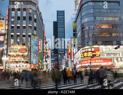 Kabukicho, crossing at nightfall, Shinjuku, Tokyo, Japan - Stock Photo