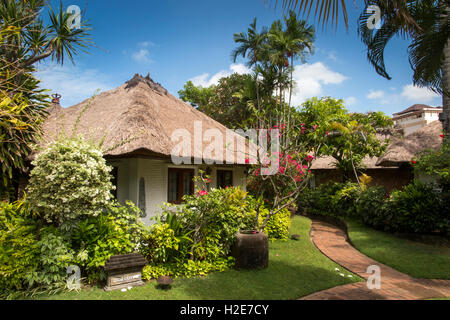 Indonesia, Bali, Kuta, Poppies Gang 1, Poppies Cottages, tourist cottage in garden - Stock Photo