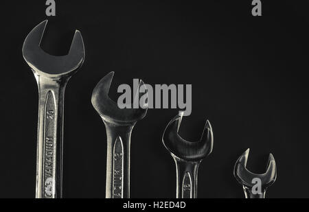 Set of four wrenches of different sizes. - Stock Photo
