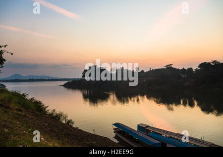Sunset over the Xe Don river where it meets the Mekong river in Pakse in the Champasak province in south Laos - Stock Photo