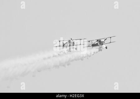 bi-plane in flight during an air show - Stock Photo