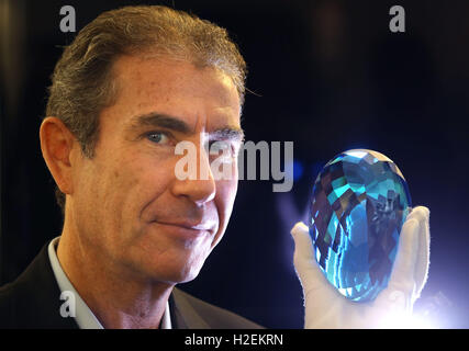 Maurice Ostro from Ostro Minerals holds the world's largest topaz, a 9,831 carat stone which was discovered by his - Stock Photo