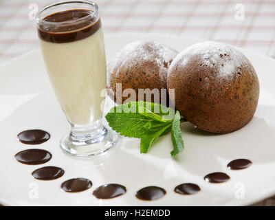 two freshly baked brownie-type sponge cake - Stock Photo
