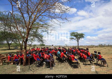 Kajiado, Kenya. 28th Oct, 2016. Students attend the ceremony for the last day of school term at Olgumi primary school, - Stock Photo