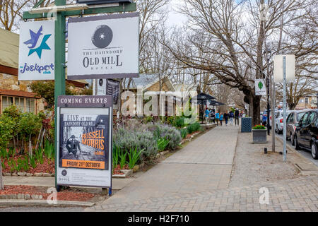 Tourists stroll along the sidewalk outside the 'Old Mill' hotel in Hahndorf, in South Australia's picturesque Adelaide - Stock Photo