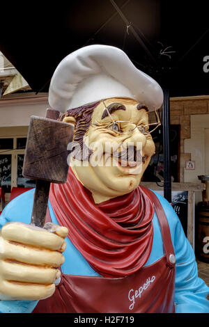 A statue of Gepetto outside Gepetto's restaurant in Hahndorf South Australia's picturesque Adelaide Hills. - Stock Photo