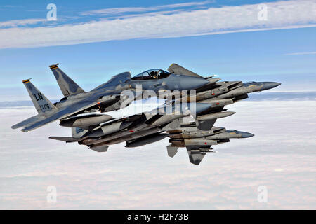 U.S. Air Force F-15C Eagle jet aircrafts break formation during flight operations at the Royal Air Force Lakenheath - Stock Photo