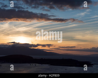 Sunset over Mull and Kerrera from McCaigs Tower Oban Argyll and Bute Scotland - Stock Photo