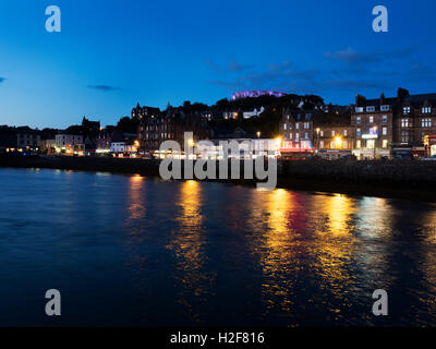 Floodlit McCaigs Tower over the Waterfront at Dusk Oban Argyll and Bute Scotland - Stock Photo