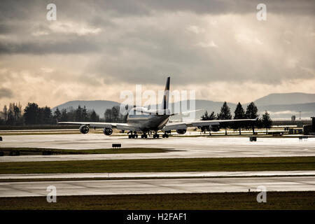 Lufthansa Boeing 747 taxiing down the tarmac, Vancouver International Airport, British Columbia. - Stock Photo