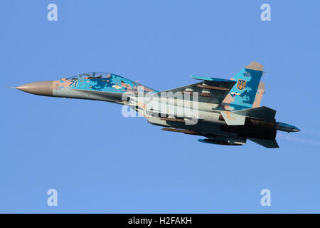 Military aviation. Sukhoi Su-27UB Flanker jet fighter airplane of the Ukraine Air Force flying in the sky - Stock Photo