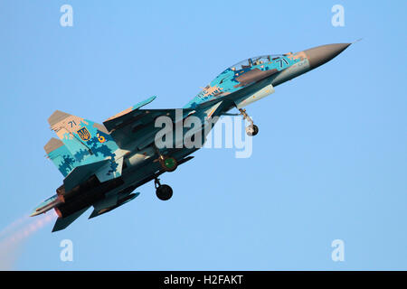 Ukraine Air Force Sukhoi Su-27UB Flanker jet fighter aircraft flying at an air display - Stock Photo