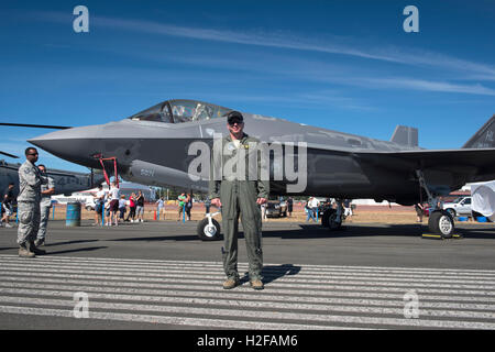 Lt-Col. George Watkins stands in front of his Stealth F-35A fighter jet, at the Abbotsford airshow, British Columbia. - Stock Photo