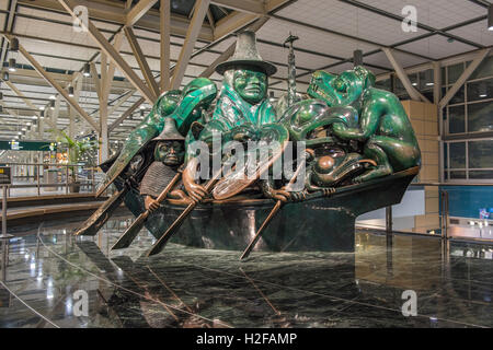 The Spirit of Haida Gwaii The Jade Canoe, Bill Reid's bronze sculpture displayed at the Vancouver International - Stock Photo