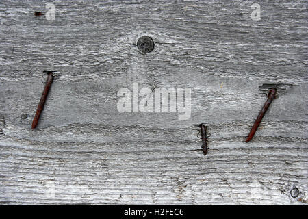 Fragment of an old aged wooden fence pattern with rusty nails. Can be used as a background or wallpaper - Stock Photo