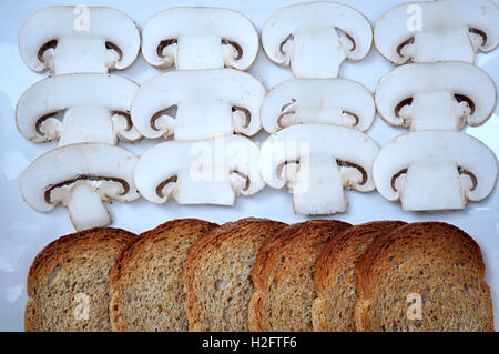 slices of bread and mushrooms - Stock Photo