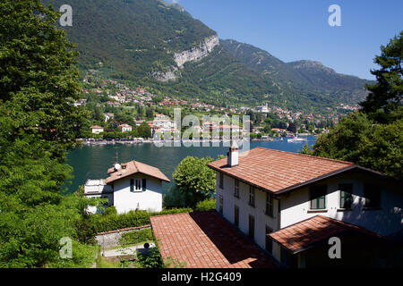 View across the lake from high up at Lake Como Italy at Lenno on lakeside with mountain in background - Stock Photo