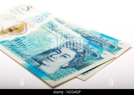 The New waterproof Polymer UK Five Pound Note - Stock Photo