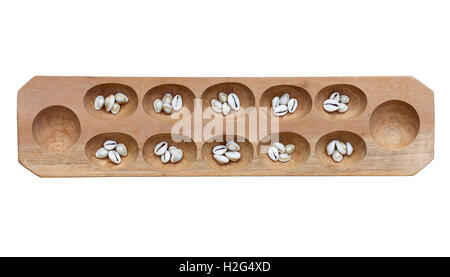 Mancala board with shells on white. Mancala is a traditional board game played around the world. - Stock Photo