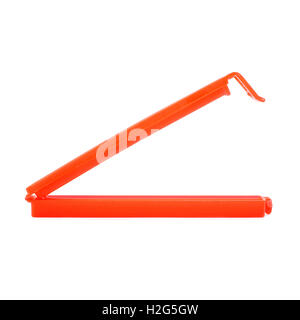 Plastic peg pin isolated over the white background - Stock Photo
