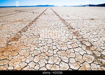 Tire tracks in Alvord 'Lake' (Playa) in the Alvord Desert in southeastern Oregon - Stock Photo