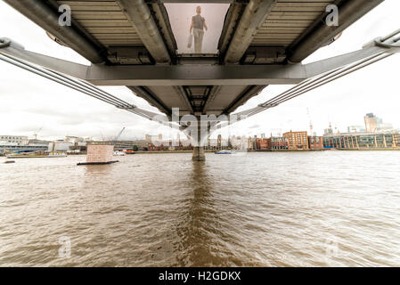 view from below the Millenium bridge over the River Thames - Stock Photo