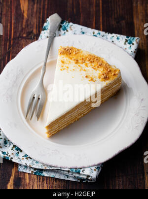 Honey Layered Cake On A White Plate Wooden Background Stock Photo