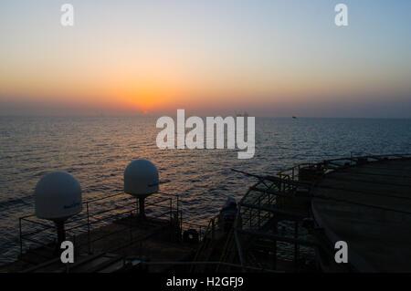 Azerbaijan. Caspian Sea. Sunset as seen from the DBA barge at an oil field in the Caspian Sea. - Stock Photo