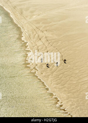 Rusheen Bay, horse riders on sandy beach, Galway, County Clare, Ireland - Stock Photo