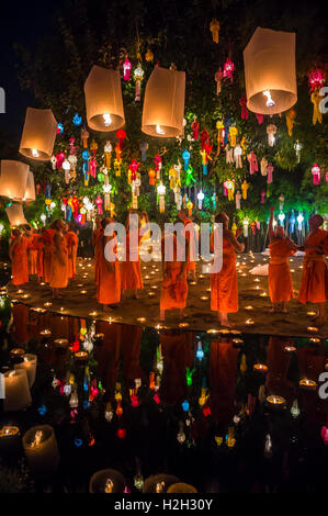CHIANG MAI, THAILAND - NOVEMBER 07, 2014: Group of Buddhist monks launch sky lanterns at the annual Yee Peng festival - Stock Photo